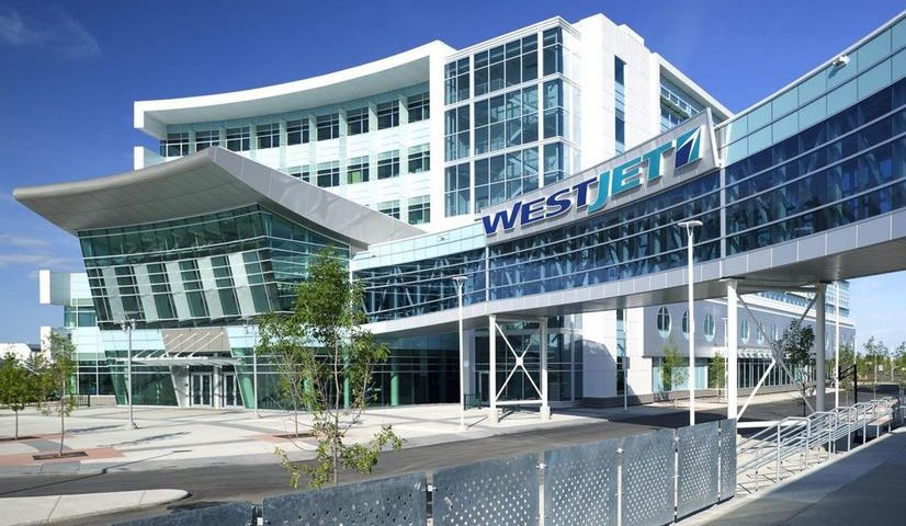 WestJet shares hit two-year high on record quarterly load numbers