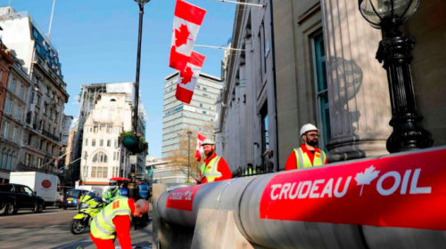 Pipeline protest greets Trudeau in London ahead of meetings with Queen, May