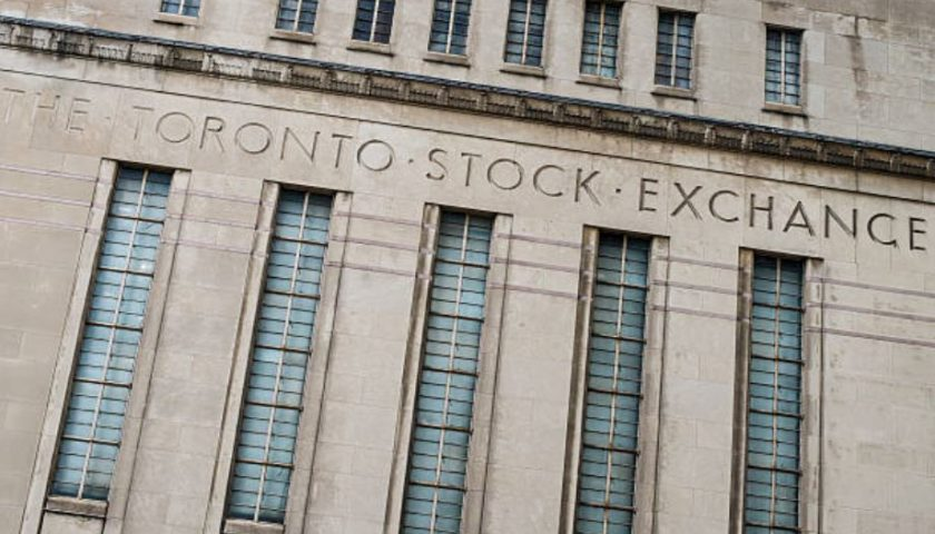 Toronto stock index, Wall Street gain ground, as Canadian dollar weakens