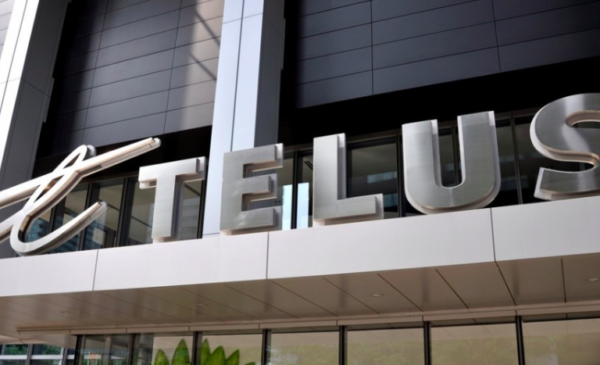 Telus raises dividend, reports third-quarter profit down from year ago mark