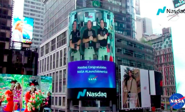 Astronauts ring opening bell for Nasdaq from space station